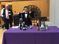 Head of the Recognition Gala Committee Candie Tanaka working hard at the beer and wine cash bar!