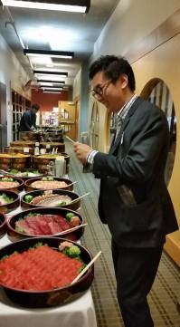 Volunteer Coordinator Allan Cho on sushi duty. Thanks to Allan and our many volunteers at the Gala for all of their hard work!